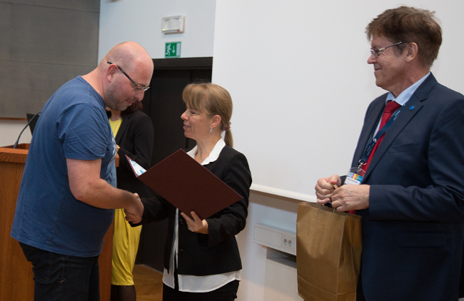 Gregor receiving the award for best computer science teacher in Slovenia